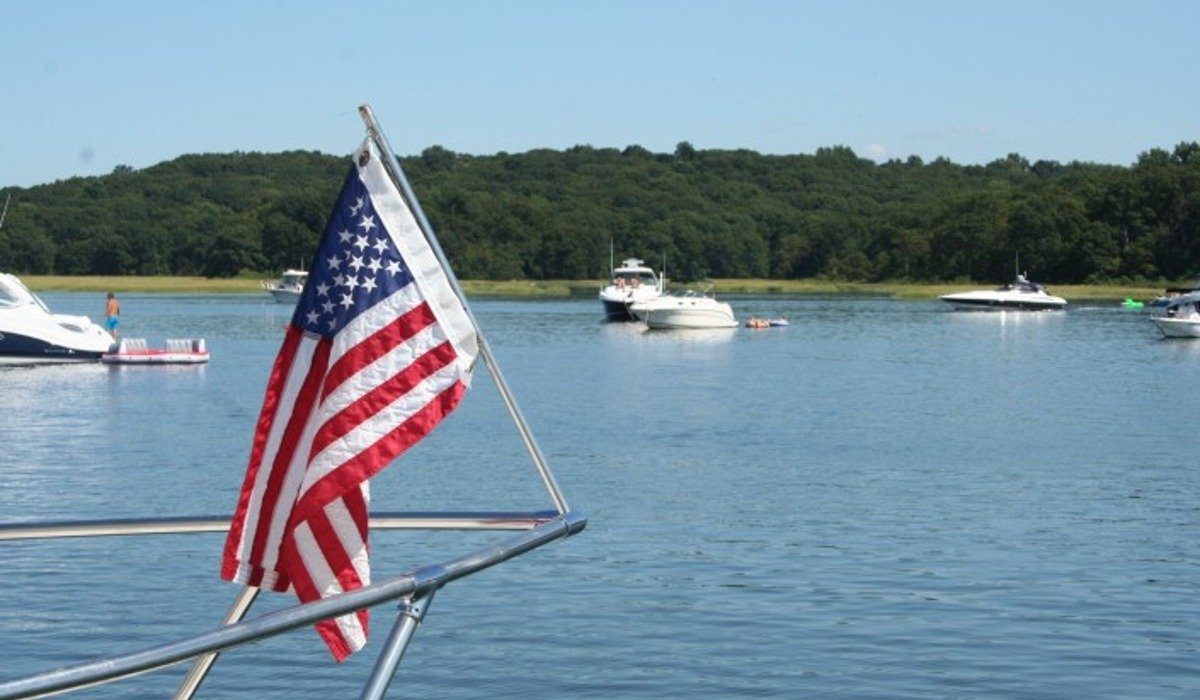 American flag on front of boat overlooking bay area