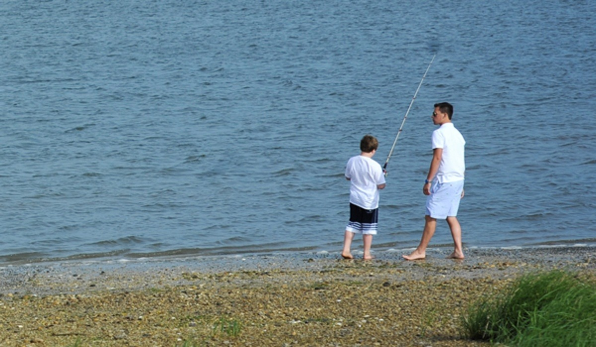 Father and son fishing at the beach