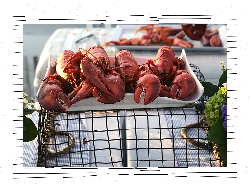 lobsters-sitting-on-a-plate-on-top-of-a-basket